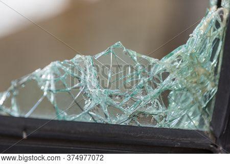 Broken Window Shards Of Automotive Glass In A Metal Frame