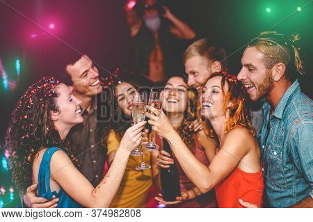 Happy Friends Celebrating New Year Eve Holidays In Disco Club - Young People Doing Private Party Wit