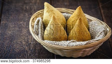 Coxinha Of Chicken, Brazilian Snack Made Of Shredded And Fried Chicken, Breaded In Flour.