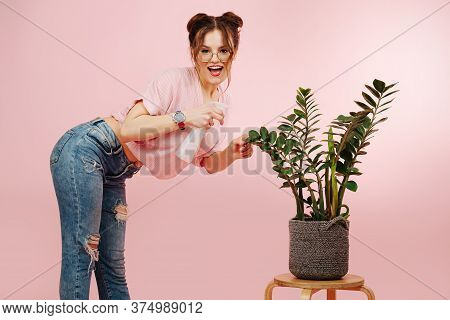 Provocative Eccentric Overly Happy Girl Watering Plant With Sprinkler