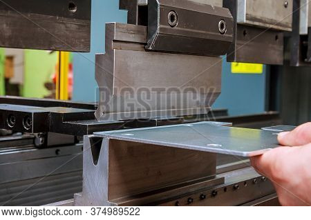 Bending Sheet Metal With A Hydraulic Machine At The Factory
