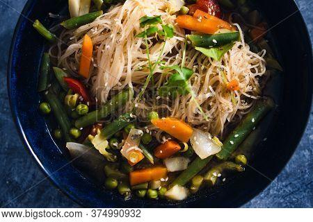 Plant-based Food, Vegan Singaporean Laksa Soup With Vermicelli Noodles And Stir Fry Veggies