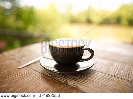 Hot Mocha Coffee Or Cappuccino In The Brown Cup On The Wooden Table.