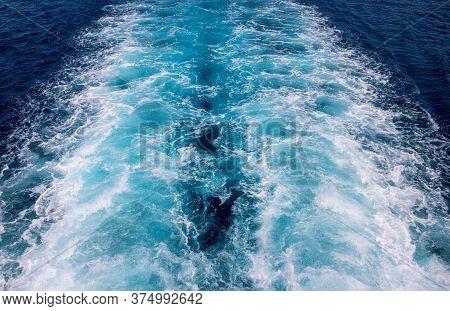 Speed Boat Trail On Sea Water Photo. White Foam On Blue Water. Ocean Transportation. Tropical Island