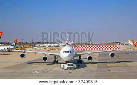 JOHANNESBURG - APRIL 18:Airbus A340 taxing for disembarking passengers on April 18, 2012 in Johannesburg, South Africa. Johannesburg Tambo airport is the busiest airport in Africa