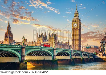 Big Ben and westminster bridge in London at sunrise