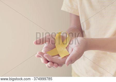 Hands Holding Yellow Gold Ribbon, Sarcoma Awareness, Bone Cancer, Childhood Cancer Awareness, Septem