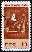 GDR - CIRCA 1967: a stamp printed in GDR shows Girl Gathering Grapes, Painting by Gerard Dou, circa 1967 poster