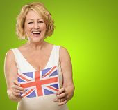 Mature Woman Holding United Kingdom Flag On Green Background poster
