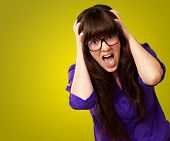 Frustrated Woman With Mouth Open Isolated On Yellow Background poster
