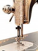front part of old sewing machine against the white wall poster