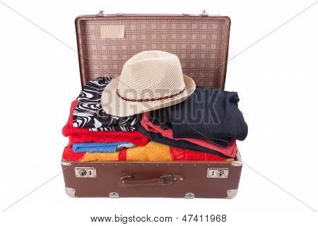 Vintage Suitcase Overstuffed With A Summer Hat