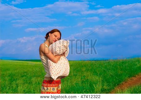 Beautiful Woman With Pillow In The Elbowroom