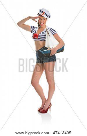 Sexy pin-up woman posing as a sailor girl
