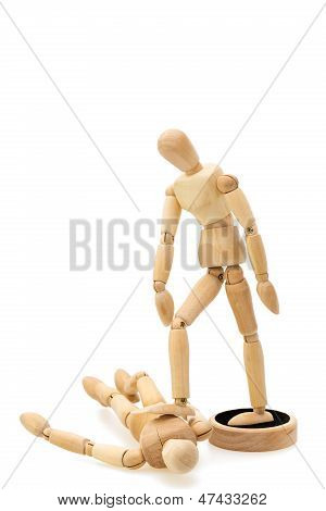 Concept Of Victor And Beaten: One Wooden Mannequin / Doll Standing Over Lying Doll