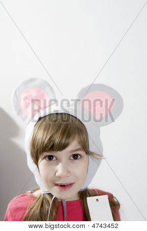 Little Girl Wearing Mouse`s Ears Laugh
