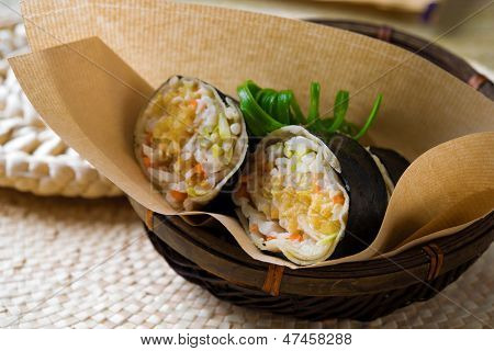 Closeup of a Malaysia popiah fresh spring roll  filling with turnip, Jicama, bean sprouts, grated carrots, tofu and chopped peanuts.