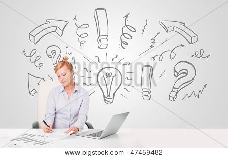 Attractive young businesswoman brainstorming with drawn arrows and symbols