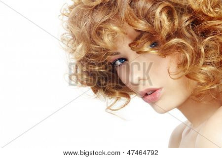 Portrait of young beautiful woman with curly hair over white background, selective focus, copy space at the left