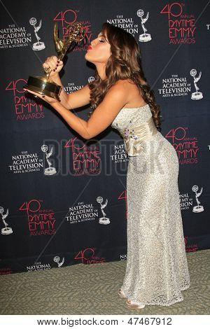 BEVERLY HILLS - JUN 16: Kristen Alderson with the Outstanding Younger Actress In A Drama Series award for 'General Hospital' - 40th Annual Daytime Emmy Awards on June 16, 2013 in Beverly Hills, CA