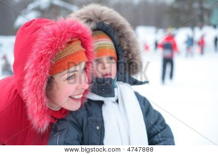 Mother With Son Without Foreteeth Outdoor In Winter