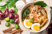 Singapore prawn noodles or prawn mee. Famous Singaporean food spicy fresh cooked har mee in clay pot with hot steam. Asian cuisine. poster