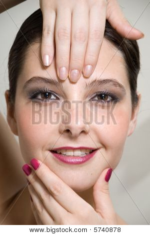Woman with both hands on her face