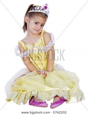 A cute little girl dressed in a princess costume isolated on a white background poster