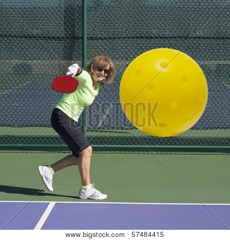 Pickleball Action - Senior Woman Hitting Backhand