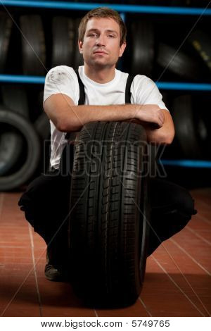 Mechanic With Tyre