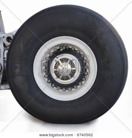 Huge aircraft tyre isolated in white background. poster
