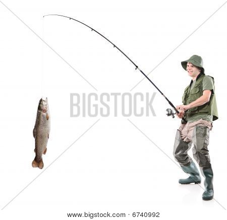Young euphoric fisherman catching a fish