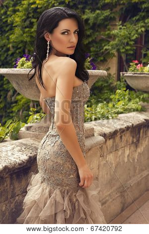 Beautiful Woman In Luxurious Beige Dress Posing At Summer Park