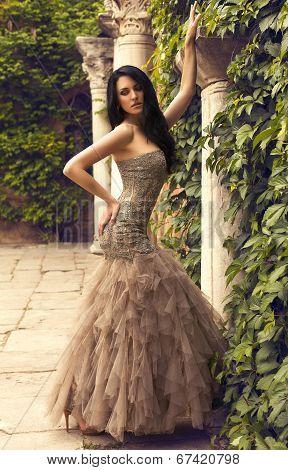 Beautiful Woman In Luxurious Beige Dress Posing At Antic Park