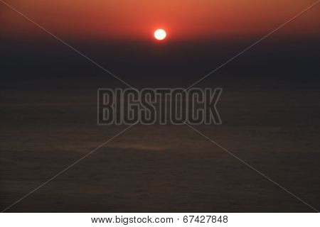 Deep red sunset over the sea background poster