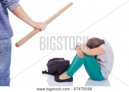 Male hand holding a wooden stick to beaten on a little girl, isolated on a white background
