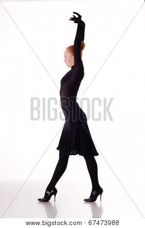young beauty dancer on high heels isolated on white