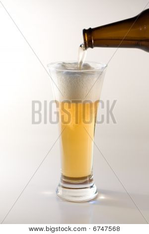 Pouring beer in glass