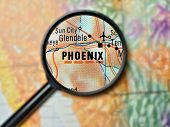 Close up of Phoenix, Arizona under a magnifying glass on a map poster