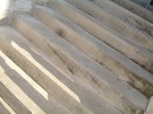 angled view of old cement steps poster