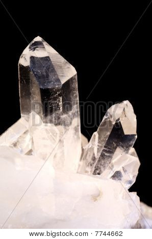 Quartz crystals on black background with copy space poster