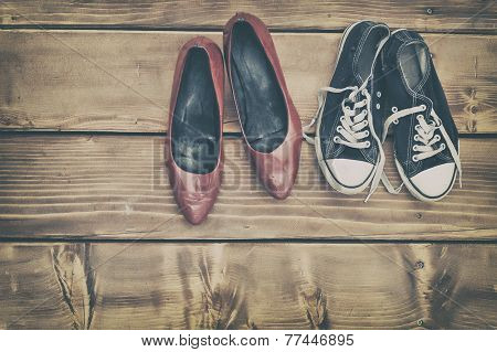 Different Shoes On A Wooden Table