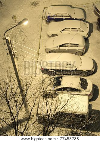 cars on the parking in courtyard at night, winter