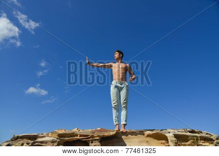 Healthy lifestyle concept.- full body young man do kungfu - taichi outside