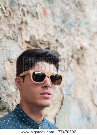 Fashionable Man Portrait Over Ruinous Wall