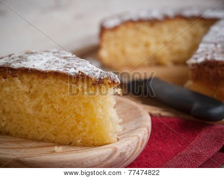 Portion Of A Sponge Cake On A Wooden Plate