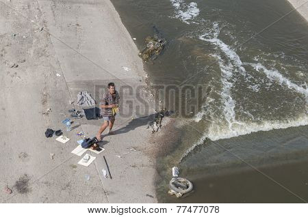 Homeless Man Washes In River