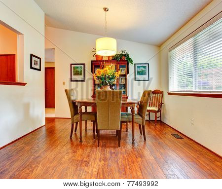 Bright Dining Room With Vaulted Ceiling