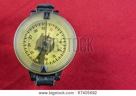 Vintage German WW2 airforce pilot wrist compass on red velvet background