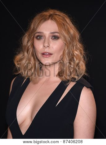LOS ANGELES - FEB 20:  Elizabeth Olsen arrives to the Tom Ford Autumn/Winter 2015 Womenswear Collection Presentation  on February 20, 2015 in Hollywood, CA